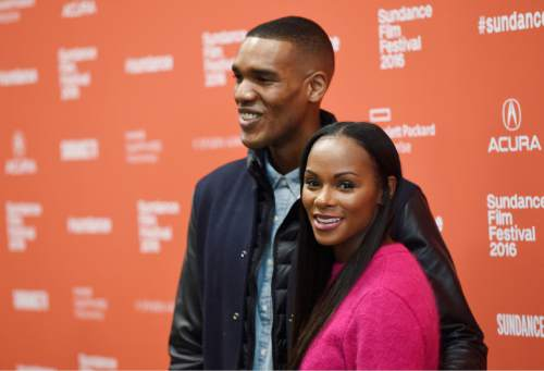 "Parker Sawyers, left, and Tika Sumpter, who play Barack Obama and Michelle Obama in ""Southside With You,"" pose together at the premiere of the film at the 2016 Sundance Film Festival on Sunday, Jan. 24, 2016, in Park City, Utah. (Photo by Chris Pizzello/Invision/AP)"