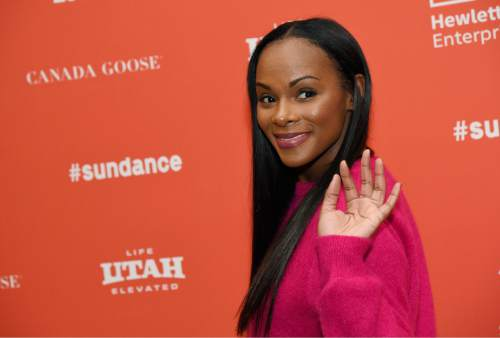 "Tika Sumpter, who plays a young Michelle Obama in ""Southside With You,"" waves to photographers at the premiere of the film at the 2016 Sundance Film Festival on Sunday, Jan. 24, 2016, in Park City, Utah. (Photo by Chris Pizzello/Invision/AP)"