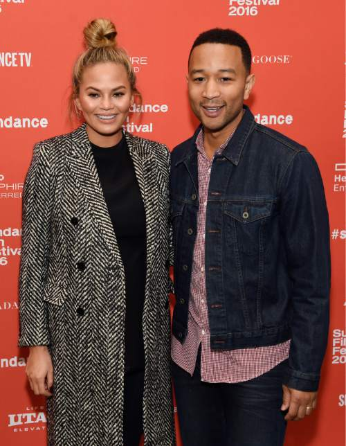 "Singer John Legend, right, executive producer of ""Southside With You,"" and his wife Chrissy Teigen pose together at the premiere of the film at the 2016 Sundance Film Festival on Sunday, Jan. 24, 2016, in Park City, Utah. (Photo by Chris Pizzello/Invision/AP)"
