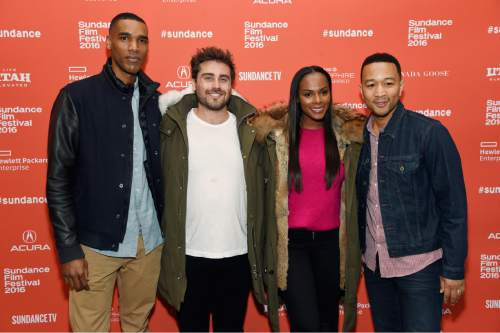 "Richard Tanne, second from left, writer/director of ""Southside With You,"" poses with cast members Parker Sawyers, far left, and Tika Sumpter, third from left, and executive producer John Legend at the premiere of the film at the 2016 Sundance Film Festival on Sunday, Jan. 24, 2016, in Park City, Utah. (Photo by Chris Pizzello/Invision/AP)"