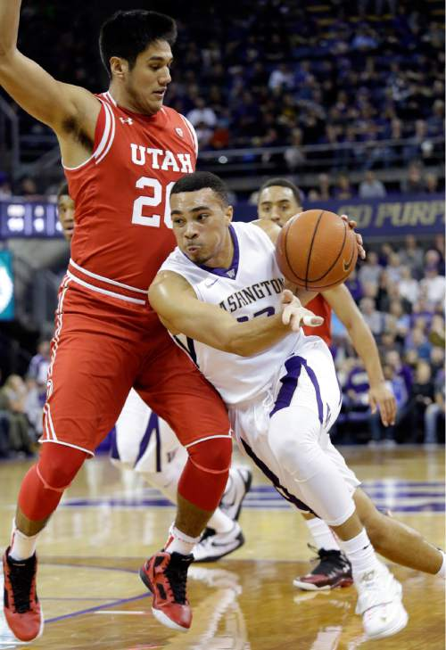 Washington's Andrew Andrews, right, drives against Utah's Chris Reyes in the first half of an NCAA college basketball game, Sunday, Jan. 24, 2016, in Seattle. (AP Photo/Elaine Thompson)