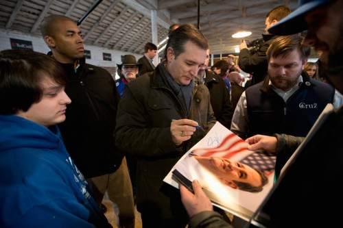 Republican presidential candidate, Sen. Ted Cruz, R-Texas signs his autograph at a campaign event at High Point Bulls Oswald Barn Tuesday, Jan. 26, 2016, in Osceola, Iowa. (AP Photo/Jae C. Hong)