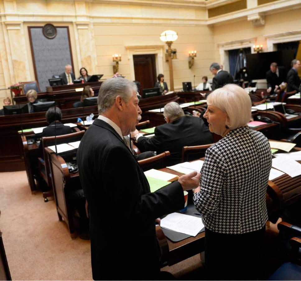 Al Hartmann  |  The Salt Lake Tribune Senate Minority Leader Gene Davis, D-Salt Lake City, and Senate Minority Whip Karen Mayne, D-West Valley City, huddle in conversation prior to opening of the 2016 Utah Legislature Monday Jan. 25.