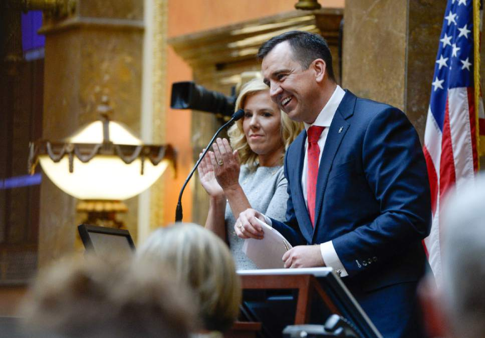 Francisco Kjolseth | The Salt Lake Tribune Speaker of the House, Greg Hughes is joined by his wife Krista as he concluded his opening remarks for the start of the 2016 Legislative session on Monday, Jan. 25, 2016 at the Utah Capitol.