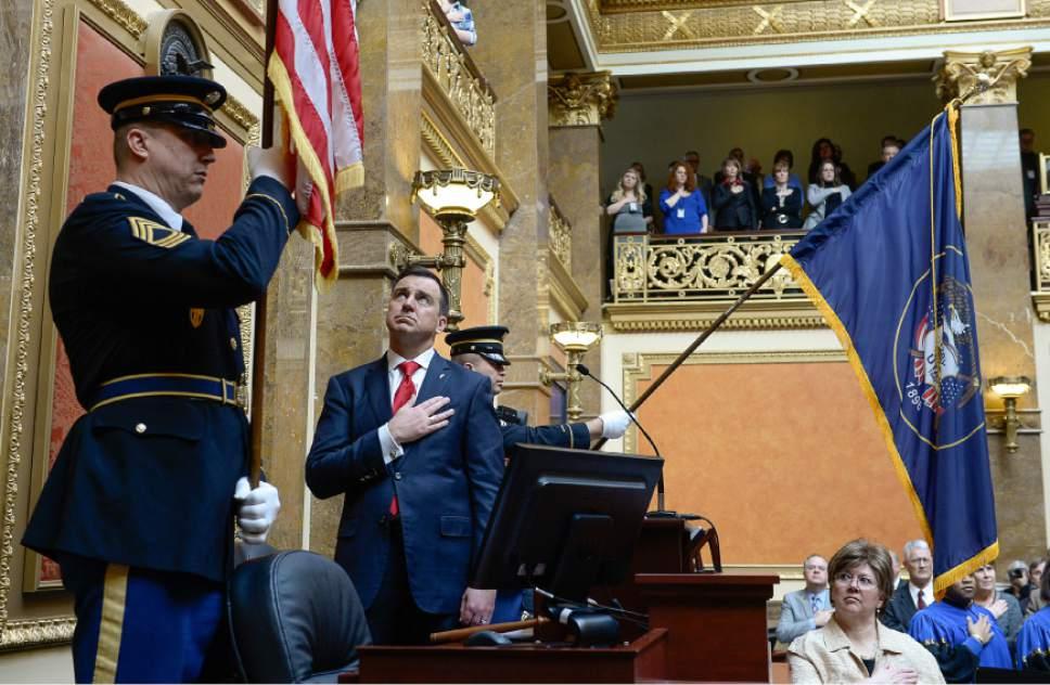 Francisco Kjolseth | The Salt Lake Tribune Master Sgt. Allen Jackson with the Utah National Guard posts the colors alongside Speaker of the House, Greg Hughes, for the start of the 2016 Legislative Session on Monday, Jan. 25, 2016 at the Utah Capitol.