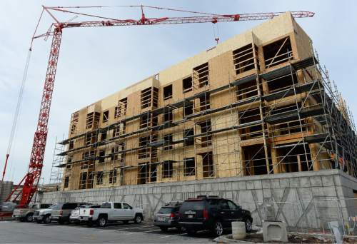 Francisco Kjolseth | The Salt Lake Tribune A new apartment building is constructed west of Pioneer Park in Downtown Salt Lake City.