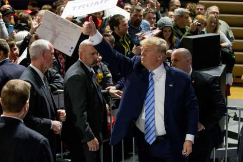 Republican presidential candidate Donald Trump greets members of the audience after speaking at a rally at Muscatine High School in Muscatine, Iowa, Sunday, Jan. 24, 2016. (AP Photo/Andrew Harnik)