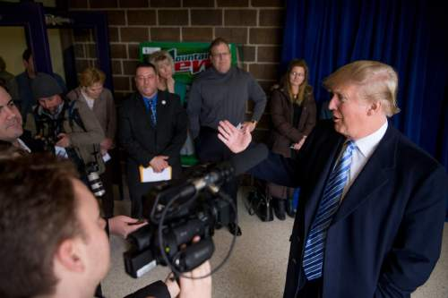 Republican presidential candidate Donald Trump speaks to members of the media as he arrives for a rally at Muscatine High School in Muscatine, Iowa, Sunday, Jan. 24, 2016. (AP Photo/Andrew Harnik)
