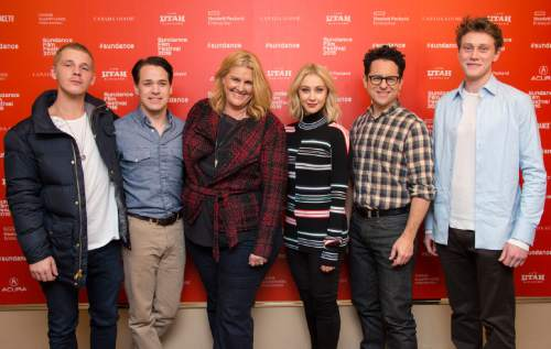 "From left, actors Daniel Webber and T.R. Knight, executive producer/writer Bridget Carpenter, actress Sarah Gadon, executive producer J.J. Abrams and George MacKay  pose at the premiere of ""11.22.63"" during the 2016 Sundance Film Festival on Thursday, Jan. 28, 2016, in Park City, Utah. (Photo by Arthur Mola/Invision/AP)"
