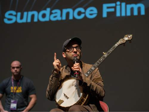 """Steve Griffin     The Salt Lake Tribune   Josh Fox, director of the movie """"How to Let Go of the World and Love All The Things Climate Can't Change"""", plays his banjo after answering questions from Utah students who attend a screening of the Sundance film at the Rose Wagner Theatre in Salt Lake City, Friday, January 29, 2016."""