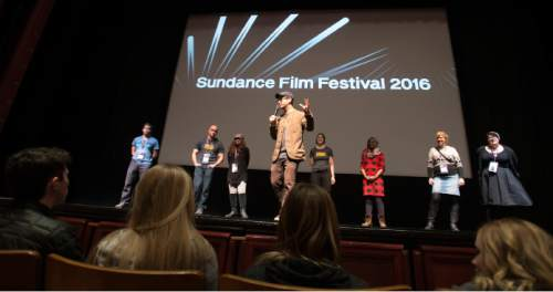 """Steve Griffin     The Salt Lake Tribune   Josh Fox, director of the movie """"How to Let Go of the World and Love All The Things Climate Can't Change"""", answers question from Utah students who attend a screening of the Sundance film at the Rose Wagner Theatre in Salt Lake City, Friday, January 29, 2016."""