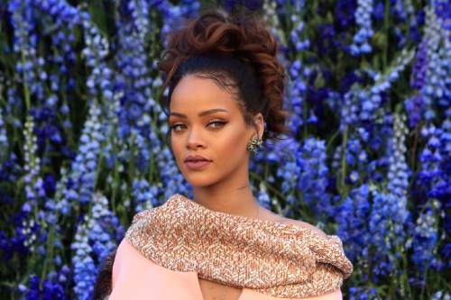 """FILE - In this Friday, Oct. 2, 2015, file photo, singer Rihanna poses before Christian Dior's Spring-Summer 2016 ready-to-wear fashion collection to be presented during the Paris Fashion Week, in Paris. Rihanna has released her much anticipated new album through Jay Z's Tidal streaming service, which she co-owns. Rihanna released """"ANTI"""" on Thursday, Jan. 28, 2016, on the streaming service. (AP Photo/Thibault Camus, File)"""
