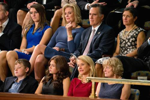 2012 Republican presidential candidate Mitt Romney, center right, and his wife Ann, center left, sit in the House Chamber gallery on Capitol Hill in Washington, Thursday, Oct. 29, 2015, as Rep. Paul Ryan, R-Wis., is expected to be voted in as the new House Speaker. Ryan's wife Janna, is at bottom second from right. (AP Photo/Andrew Harnik)