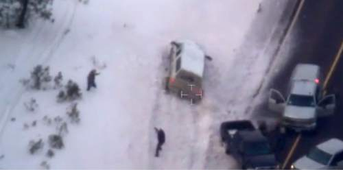 "This photo taken from an FBI video shows Robert ""LaVoy"" Finicum before he was fatally shot by police Tuesday, Jan. 26, 2016 near Burns, Ore.  A video released Thursday, Jan. 28, 2016 by the FBI of the shooting death of a spokesman for the armed occupiers of a wildlife refuge shows the man reaching into his jacket before he fell into the snow. The FBI said the man had a gun in his pocket. (FBI via AP)"