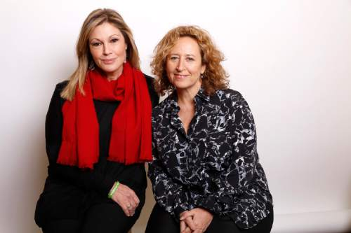 "Producer Maria Cuomo Cole, left, and director Kim A. Snyder pose for a portrait to promote the film, ""Newtown"", at the Toyota Mirai Music Lodge during the Sundance Film Festival on Sunday, Jan. 24, 2016, in Park City, Utah. (Photo by Matt Sayles/Invision/AP)"