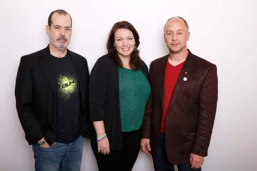 """David Wheeler, from left, Nicole Hockley and Mark Barden pose for a portrait to promote the film, """"Newtown"""", at the Toyota Mirai Music Lodge during the Sundance Film Festival on Sunday, Jan. 24, 2016, in Park City, Utah. (Photo by Matt Sayles/Invision/AP)"""