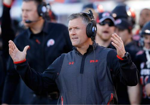 FILE - This Oct. 31, 2015, file photo, Utah head coach Kyle Whittingham looks on in the first quarter during an NCAA college football game against Oregon State, in Salt Lake City. There is no rivalry between Utah and Colorado. Neither team is ranked, the Buffalos are out of the bowl picture and the Utes are out of Pac-12 championship contention. There's little on the line in the regular-season finale for the two programs.(AP Photo/Rick Bowmer, File)
