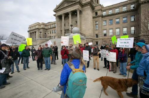 """Keep Public Lands Public"" rally organizer Katie Fite, with Wildlands Defense (middle, back to camera) talks with attendees outside of the Idaho State Capitol on Saturday January 30, 2016. Kyle Green for The Salt Lake Tribune"