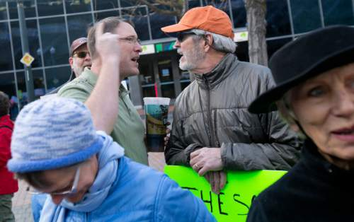 """""""Keep Public Lands Public"""" rally attendee Richard Prange (right) argues with and unidentified attendee (left, he refused to give his name) of a Western Rangelands Property Rights Workshop held at the Boise Centre in Boise, Idaho. Saturday January 30, 2016. Kyle Green for The Salt Lake Tribune"""