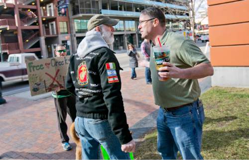 """Keep Public Lands Public"" rally attendee Bryan DuFosse (left) argues with and unidentified attendee (right, he refused to give his name) of a Western Rangelands Property Rights Workshop held at the Boise Centre in Boise, Idaho. Saturday January 30, 2016. Kyle Green for The Salt Lake Tribune"