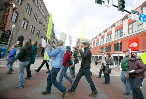 """Keep Public Lands Public"" rally attendees march from the Idaho State Capitol to the Boise Centre on Saturday January 30, 2016. Rally attendees protested outside of a Western Rangelands Property Rights Workshop at the Boise Centre. Kyle Green for The Salt Lake Tribune"