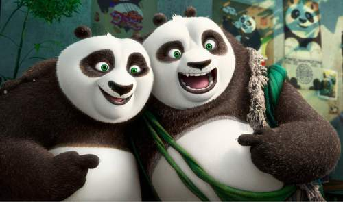 """This image released by DreamWorks Animation shows characters Po, voiced by Jack Black, left, and his long-lost panda father Li, voiced by Bryan Cranston, in a scene from """"Kung Fu Panda 3."""" (DreamWorks Animation via AP)"""