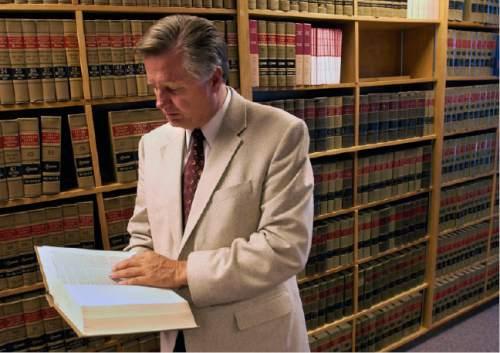 Al Hartmann  |  The Salt Lake Tribune  Deputy Salt Lake District Attorney Robert Stott is seen in the law library at the Salt Lake County Attorney's Office in the 2004 photo.