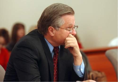 Al Hartmann  |  The Salt Lake Tribune Robert Stott  listens to proceedings at Melissa Rowland's sentencing hearing in 2004.