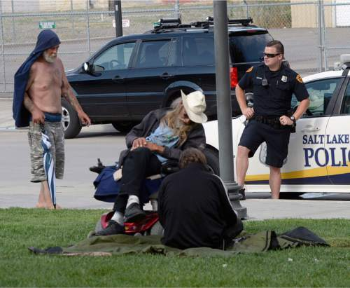 Al Hartmann  |  The Salt Lake Tribune Salt Lake Police monitor the new group of homeless who are camping out on the 500 West Commons just west of the Rio Grande Depot and a block or two south of the shelter.