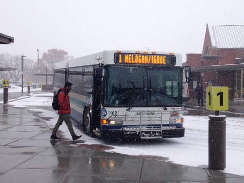 Lee Davidson  |  The Salt Lake Tribune  Buses from the Cache Valley Transit District pick up passengers at Logan's Transit Center.