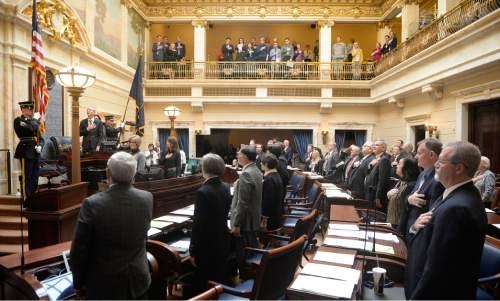 Al Hartmann  |  The Salt Lake Tribune Members of the Utah Senate stand for the national anthem to open the 2016 Utah Legislature Monday Jan. 25.