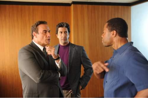John Travolta as Robert Shapiro, David Schwimmer as Robert Kardashian, and Cuba Gooding, Jr. as O.J. Simpson in ìThe People V. O.J. Simpson: American Crime Story.î Ray Mickshaw     FX