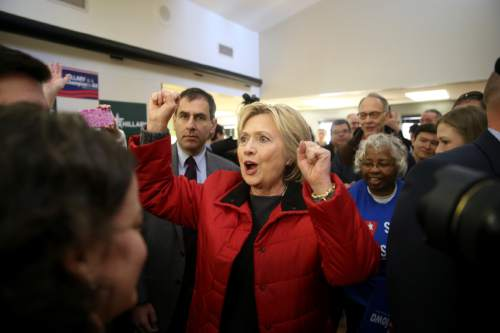 Democratic presidential candidate Hillary Clinton meets with staff at the Hillary for Iowa Office in Des Moines, Iowa, Monday, Feb. 1, 2016. (AP Photo/Andrew Harnik)