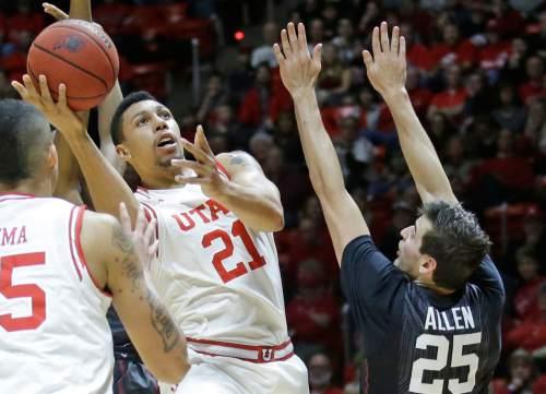 Utah forward Jordan Loveridge (21) shoots as Stanford forward Rosco Allen (25) defends during the second half of an NCAA college basketball game Saturday, Jan. 30, 2016, in Salt Lake City. Utah won 96-74. (AP Photo/Rick Bowmer)