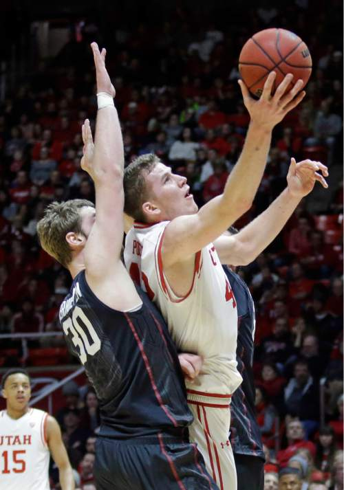 Utah forward Jakob Poeltl, right, lays the ball up as Stanford center Grant Verhoeven (30) defends during the second half in an NCAA college basketball game Saturday, Jan. 30, 2016, in Salt Lake City. (AP Photo/Rick Bowmer)