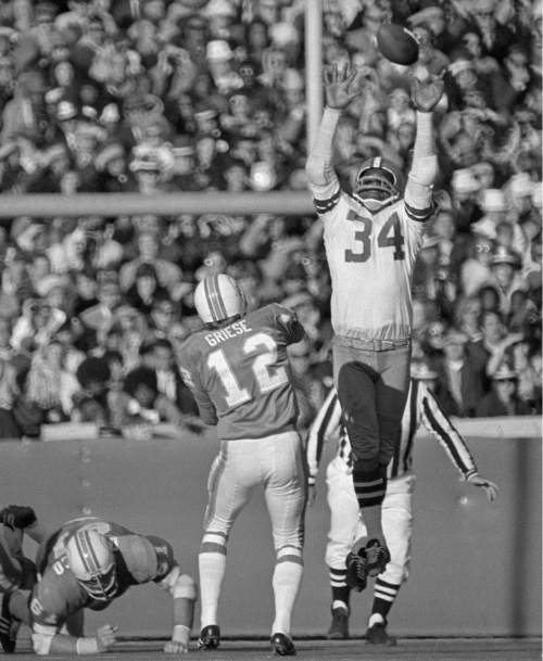 "Dallas Cowboys defensive back Cornell Green (34) leaps to deflect a Bob Griese pass intended for Paul Warfield in the second quarter of Super Bowl VI in New Orleans, Jan. 16, 1972. Coming off their Super Bowl defeat the previous year, the Cowboys dominated this game, beating the Miami Dolphins 24-3. Green would later say, ""The difference between the Dolphins and Cowboys was that the Dolphins were just happy to be in the game, and the Cowboys came to win the game."" (AP Photo)"