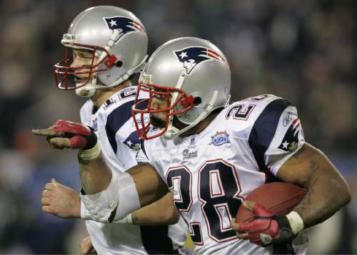 New England Patriots running back Corey Dillon (28) and quarterback Tom Brady jog off the field after Dillon scored on a 2-yard touchdown run against the Philadelphia Eagles in the fourth quarter of Super Bowl XXXIX in Jacksonville, Fla., Sunday, Feb. 6, 2005. (AP Photo/Chris O'Meara)