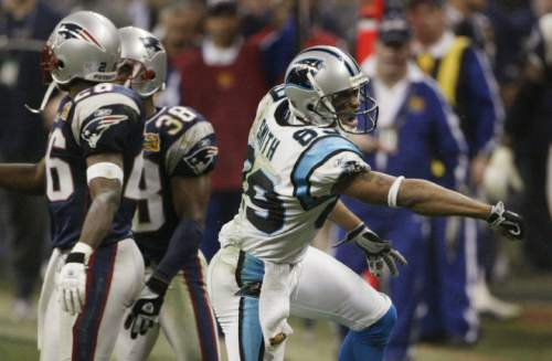 Carolina Panthers Steve Smith (89) celebrates his fourth quarter catch that set up a touchdown run by teammate DeShaun Foster during  Super Bowl XXXVIII in Houston, Sunday Feb. 1, 2004. New England Patriots defenders  Eugene Wilson, left, and Tyrone Poole, center rear,  walk away. (AP Photo/Morry Gash)