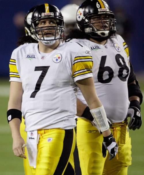 Pittsburgh Steelers quarterback Ben Roethlisberger and Pittsburgh Steelers guard Chris Kemoeatu watch replay after flag is called on play in second quarter of the NFL Super Bowl XLIII football game, Sunday, Feb. 1, 2009, in Tampa, Fla. (AP Photo/Matt Slocum)