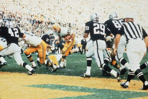 Green Bay Packers'  Marv Fleming, #81, blocks Oakland Raiders' Bill Laskey, #42, to make way for Donny Anderson's, #44, touchdown during Super Bowl II in Miami, Fla., on Jan. 14, 1968.  The Green Bay Packers beat Oakland Raiders 33-14.  (AP Photo)