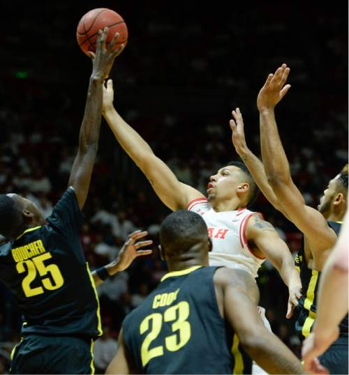 Francisco Kjolseth | The Salt Lake Tribune Utah Utes forward Jordan Loveridge (21) pushes through the Oregon defense in game action at the Huntsman Center on Thursday night.