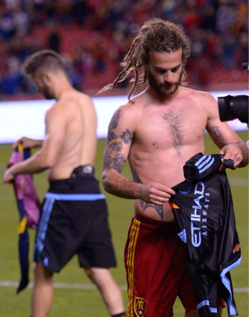 Leah Hogsten     The Salt Lake Tribune Real Salt Lake midfielder Kyle Beckerman (5) and former Real teammate New York City FC defender Chris Wingert (17) trade shirts after the game. Real Salt Lake leads New York City FC 2-0 at Rio Tinto Stadium, Saturday, May 23, 2015.