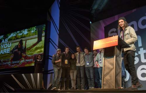 "Rick Egan  |  The Salt Lake Tribune  Miles Joris-Peyrafitte  receives the Special Jury Award for ""As You Are"" at the Sundance Film Festival Awards Ceremony in Park City, Saturday, January 30, 2016."