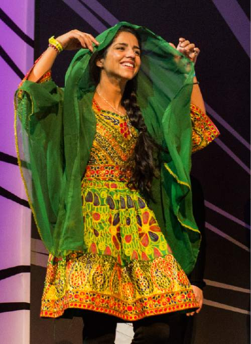"Rick Egan  |  The Salt Lake Tribune  Sonita Alizadeh walks to the podium along with filmmaker, Rokhsareh Ghaemmaghami, to accept the Grand Jury Award for ""Sonita"" which won the World Cinema Best Documentary during the Sundance Film Festival awards ceremony in Park City, Saturday, January 30, 2016.  ""Sonita"" also also won the World Cinema Documentary Audience Award."