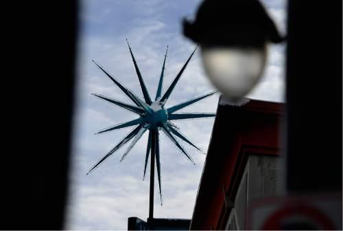 Scott Sommerdorf | The Salt Lake Tribune The Sputnik / Granite Furniture  Sign As It Looks