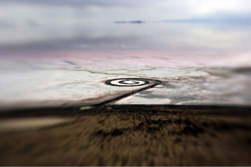 Francisco Kjolseth  |  Kjolseth Photography The Spiral Jetty earth works on the North edge of the Great Salt Lake created by artist Robert Smithson in 1970 is visible on Wednesday, Nov. 20, 2013 as seen through a unique lens with an extreme shallow depth of field. The 1,500 ft long spiral that is 15 ft wide has been below water many times since its creation in an ever changing landscape.