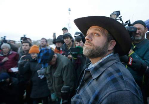 Ammon Bundy, one of the sons of Nevada rancher Cliven Bundy, speaks to reporters during a news conference at Malheur National Wildlife Refuge after meeting with Harney County Sheriff David Ward, Thursday, Jan. 7, 2016, near Burns, Ore. Ward and two other Oregon sheriffs met Thursday with Bundy, the leader of an armed group occupying a federal wildlife refuge and asked them to leave, after residents made it clear they wanted them to go home. (AP Photo/Rick Bowmer)