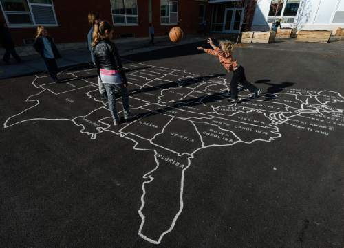 Francisco Kjolseth | The Salt Lake Tribune At Open Classroom Charter school in the avenues, students play various games during recess. A legislative task form is recommending changes to the way Utah's charter schools are funded.