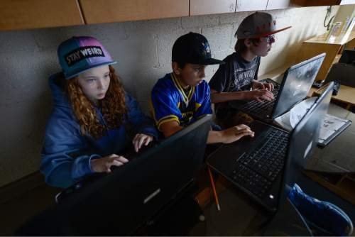Francisco Kjolseth | The Salt Lake Tribune At Open Classroom Charter school in the avenues, 6th and 7th graders design their own web sites as part of an elective class. A legislative task form is recommending changes to the way Utah's charter schools are funded.