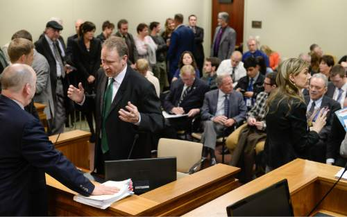 Francisco Kjolseth | The Salt Lake Tribune Senator Mark Madsen, R-Saratoga Springs, center left, sponsor of the medical marijuana bill SB73 tries to manage the overflow of people expressing interest in the hearing at the Utah Capitol. Senate Judiciary, Law Enforcement and Criminal Justice devoted its entire committee hearing to the bill and the Medical Cannabis Act.